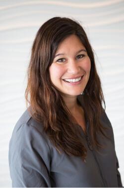 Smiling Trailside Dentistry team member in grey dental scrubs